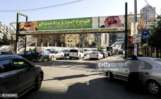 A picture taken on November 10 2017 shows a banner bearing the images of Saudi King Salman bin Abdulaziz and Crown Prince Mohammed bin Salman hanging...