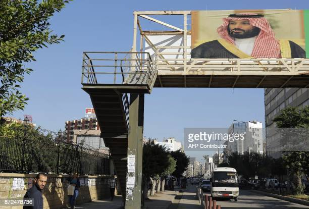 A picture taken on November 10 2017 shows a poster of Saudi Crown Prince Mohammed bin Salman hanging on a pedestrian crossing bridge in the northern...