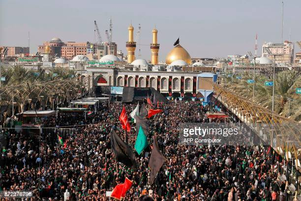 A picture taken on November 10 2017 shows Shiite pilgrims gathering in front of the Immam Hussein shrine in the southern Iraqi city of Karbala for...