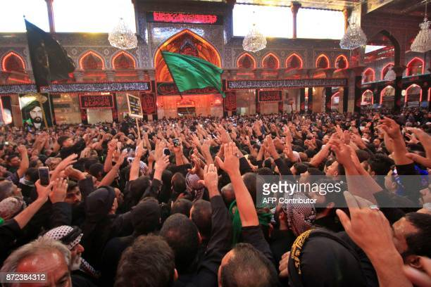 A picture taken on November 10 2017 shows Shiite pilgrims praying at the Immam Hussein shrine in the southern Iraqi city of Karbala during the...