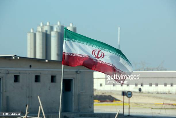 A picture taken on November 10 shows an Iranian flag in Iran's Bushehr nuclear power plant during an official ceremony to kickstart works on a second...