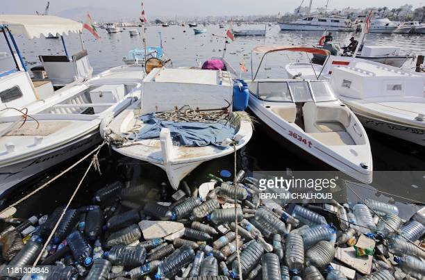 A picture taken on November 10 shows garbage littering the quay and waters of a fishing port in the northern Lebanese city of Tripoli