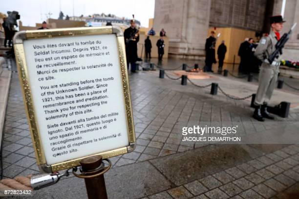 A picture taken on November 11 2017 shows a panel at the entrance of the Tomb of the Unknown soldier beneath the Arc de Triomphe in Paris during the...