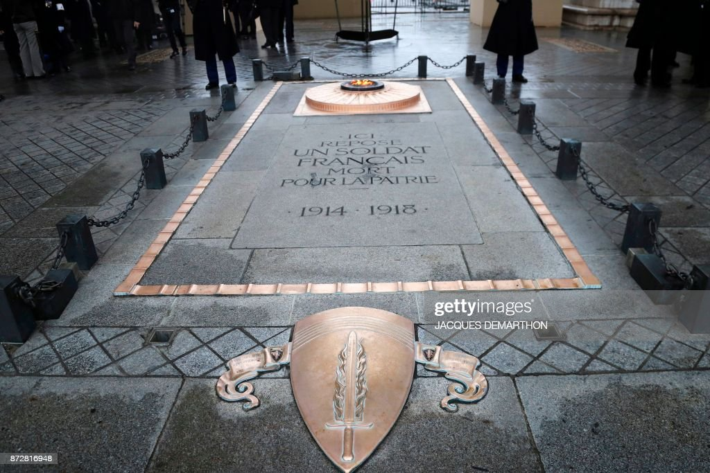 A picture taken on November 11, 2017 shows the eternal flame of the Tomb of the Unknown soldier beneath the Arc de Triomphe, in Paris, during the Armistice Day commemorations marking the end of WWI (World War One). /