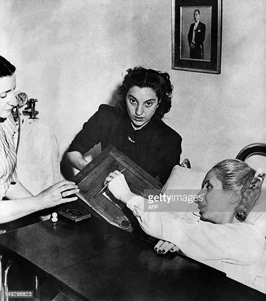 Picture taken on November 11 in Buenos Aires of Eva Peron casting her vote from a hospital bed Eva Peron known as Evita the second wife of Argentine...