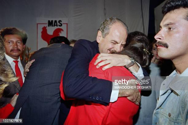 Picture taken on November 12, 1990 at Guatemala City showing the presidential candidate for Solidarity Action Movement huging his wife after early...