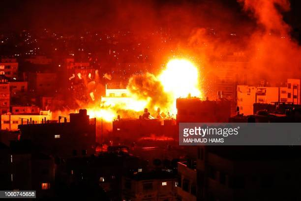 A picture taken on November 12 shows a ball of fire above the building housing the Hamasrun television station alAqsa TV in the Gaza Strip during an...