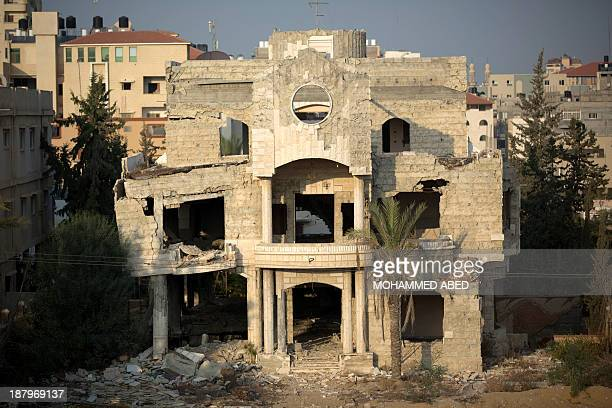 A picture taken on November 14 2013 shows a house that belonged to a palestinian family in Gaza City that was damaged during last year's Israel's...