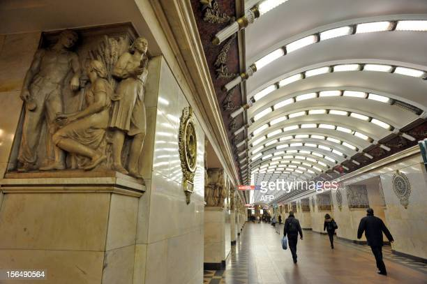 A picture taken on November 14 shows subway passengers walk at the Narvskaya metro station in SaintPetersburg AFP PHOTO / OLGA MALTSEVA