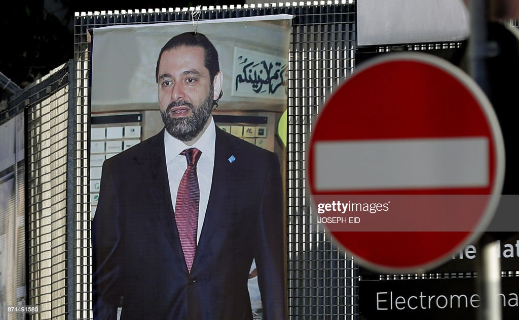 A picture taken on November 15, 2017 shows a poster of Lebanese Prime Minister Saad Hariri hanging at a street junction in the capital Beirut. /