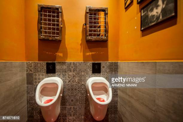 A picture taken on November 15 2017 shows toilets at a lounge bar in the Kosovo capital of Pristina / AFP PHOTO / Armend NIMANI