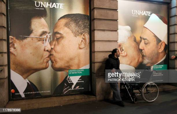 Picture taken on November 16, 2011 in Paris, shows a Benetton clothing store window covered by posters as part of the launch of a provocative...