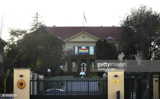 A picture taken on November 16 2017 shows a rainbow flag hanging outside the German embassy in the Turkish capital Ankara in support of the lesbian...