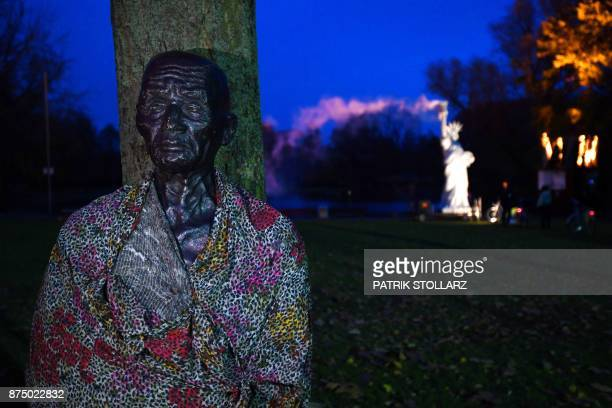 A picture taken on November 16 2017 shows a view of an installation titled 'climate refugees' created by Danish artist Jens Galschiot and displayed...