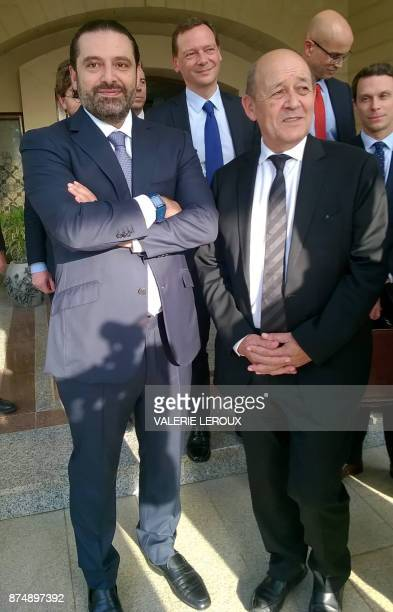 A picture taken on November 16 2017 shows French Foreign Minister JeanYves Le Drian posing for a photo with Lebanese Prime Minister Saad Hariri in...
