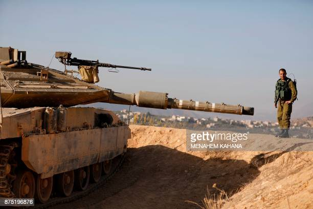 A picture taken on November 16 shows Israeli Army officer Lt Col Elad Efrati battalion commander standing next to a tank at an army position...
