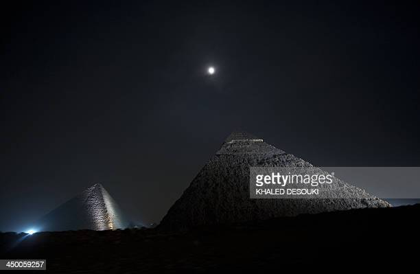 A picture taken on November 16 shows the moon above the pyramids in Giza on the outskirts of Cairo AFP PHOTO / KHALED DESOUKI