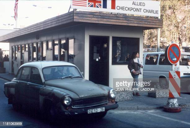 Picture taken on November 17 1989 and made available on November 9 2019 shows a man in a Wartburg car crossing the Allied Checkpoint Charlie crossing...