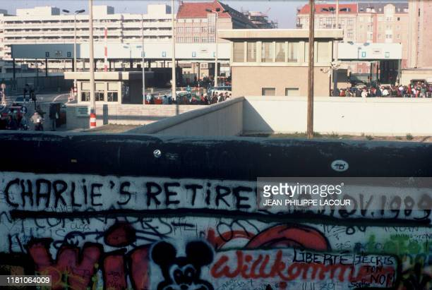 Picture taken on November 17, 1989 and made available on November 9, 2019 shows a view taken from the former West Berlin showing a part of the Berlin...