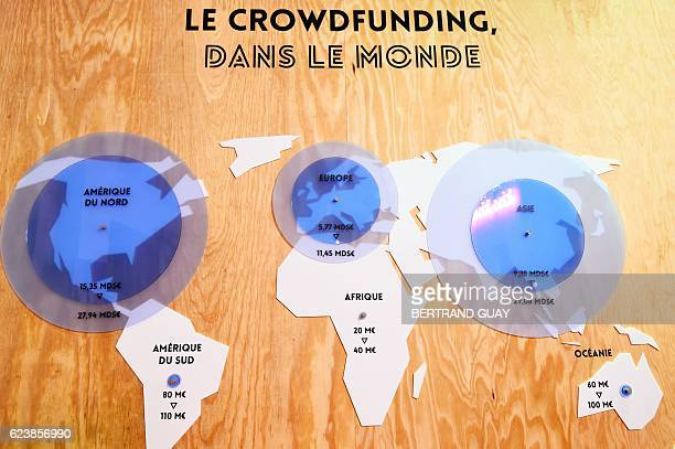 A picture taken on November 17 2016 shows a map indicating statistics of the crowdfunding platform KissKissBankBank at the company's headquarters in...