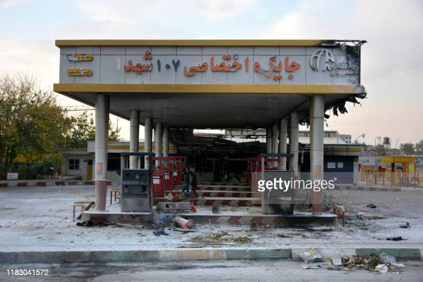 A picture taken on November 17 2019 shows a scorched gas station that was set ablaze by protesters during a demonstration against a rise in gasoline...
