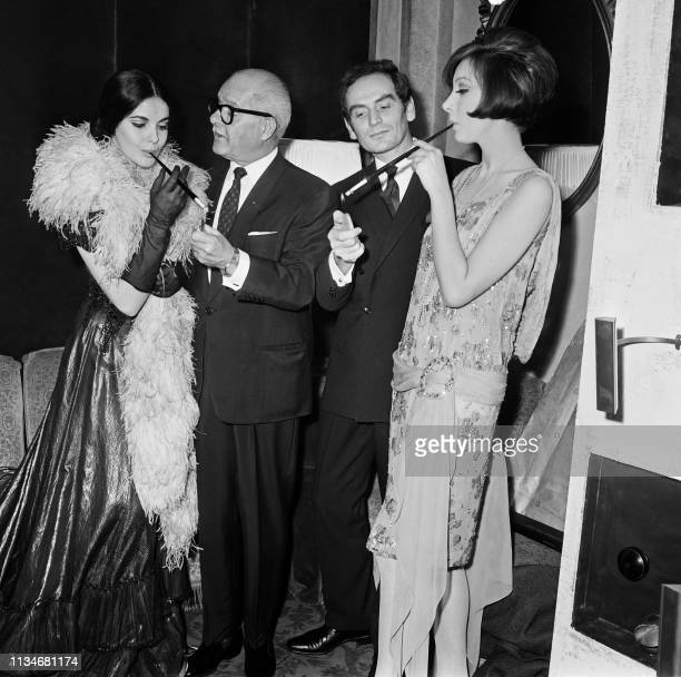 """Picture taken on November 18, 1964 at Paris, during the event """"Oscar de la mode 1963"""", showing French fashion designer Pierre Cardin and French actor..."""