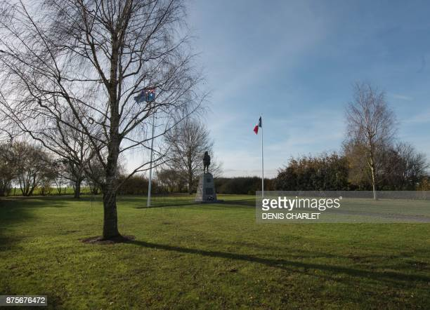 A picture taken on November 18 2017 in Bullecourt northern France shows a statue and the French and Australian flags at the WWI Australian memorial...