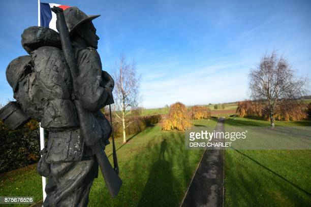 A picture taken on November 18 2017 in Bullecourt northern France shows a statue and the French flag at the WWI Australian memorial located on the...
