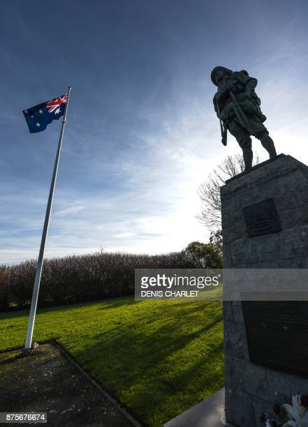 A picture taken on November 18 2017 in Bullecourt northern France shows a statue and the Australian flag at the WWI Australian memorial located on...