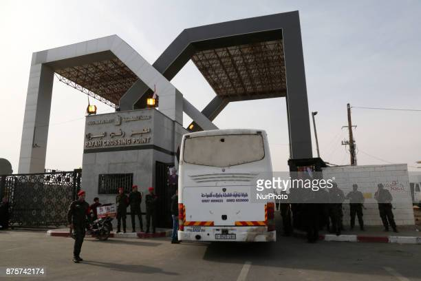 A picture taken on November 18 2017 shows a bus waiting to cross at the gates of the Rafah border crossing with Egypt in the southern Gaza strip with...