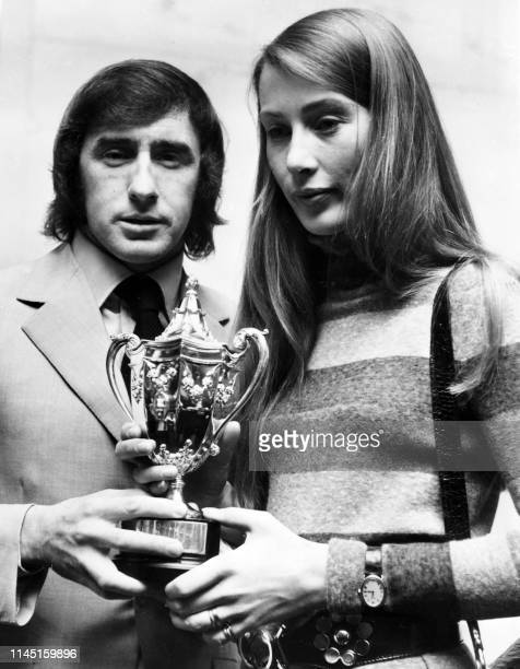 Picture taken on November 19 1970 at London showing Scottish racing driver James Stewart and Finnish born Nina Lincoln the widow of Austrian racing...