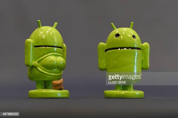 A picture taken on November 19 2015 shows ceramic figurines representing Android logo called 'Caganers' during their presentation in Torroella de...