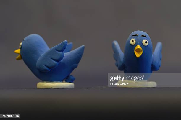 A picture taken on November 19 2015 shows ceramic figurines representing Twitter logo called 'Caganers' during their presentation in Torroella de...