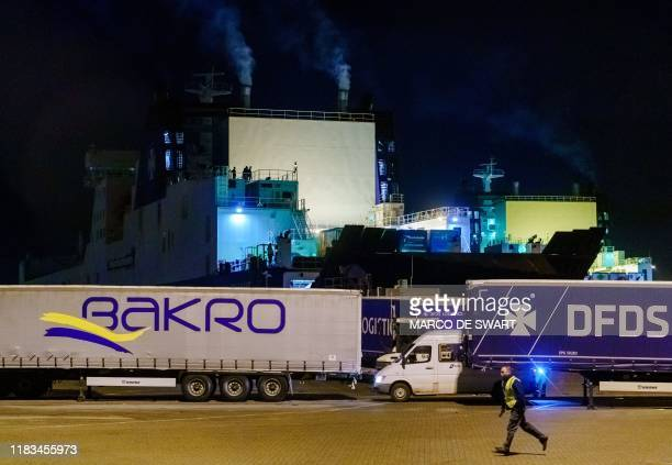 A picture taken on November 19 2019 shows a ship where 25 stowaways where found onboard in the harbour of Vlaardingen The Netherlands The ferry en...