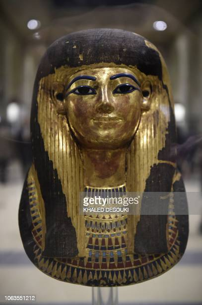 A picture taken on November 19 shows the Gilded Cartonnage Mask of Thuya Egyptian noblewoman and the wife of Yuya on display at the Egyptian Museum...