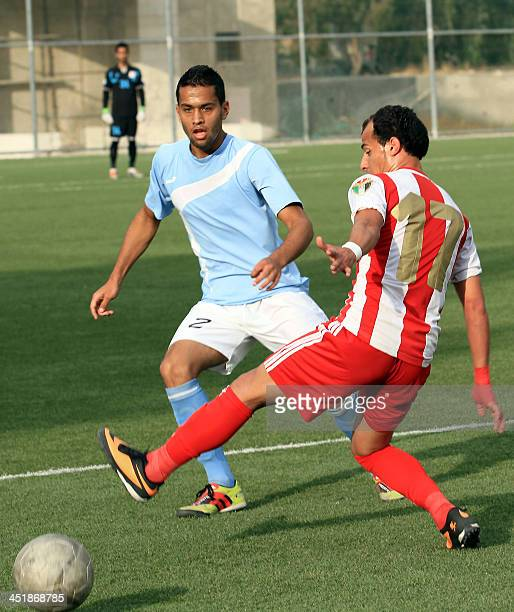 A picture taken on November 2 2013 in Amman shows 19yearold Jordan's AlFaisaly Under 20 team football player Qusai Emad alKhawalda fighting for the...