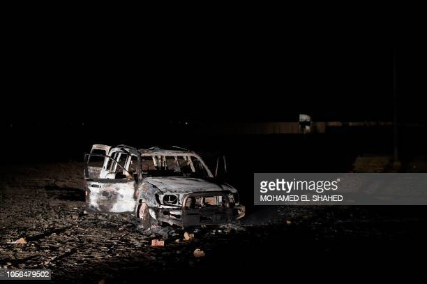 A picture taken on November 2 shows the remains of a car reportedly used by the gunmen who attacked a bus carrying Coptic Christians on the side of a...
