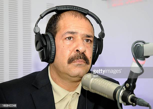 A picture taken on November 20 2012 shows Tunisian lawyer Chokri Belaid during a radio interview in Tunis Prominent Tunisian opposition leader Chokri...