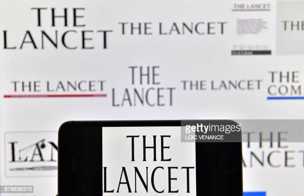 A picture taken on November 20 2017 shows logos of British peerreviewed general medical journal The Lancet displayed on computers' screens