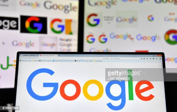 A picture taken on November 20 2017 shows logos of US multinational technology company Google displayed on computers' screens / AFP PHOTO / LOIC...