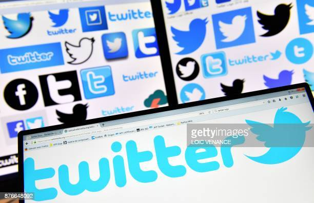A picture taken on November 20 2017 shows logos of US online news and social networking service Twitter displayed on computers' screens / AFP PHOTO /...