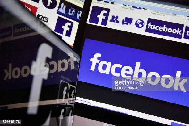 A picture taken on November 20 2017 shows logos of US online social media and social networking service Facebook / AFP PHOTO / LOIC VENANCE