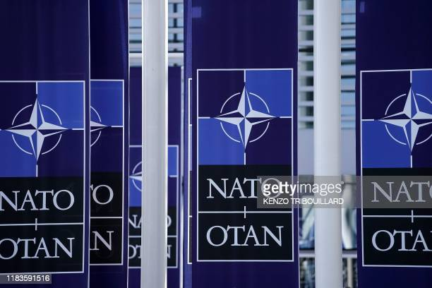 A picture taken on November 20 2019 shows NATO flags at the NATO headquarters in Brussels during a NATO Foreign Affairs ministers' summit NATO...
