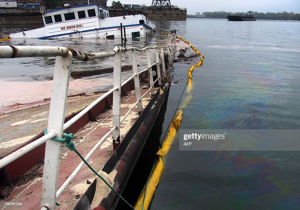 A picture taken on November 20, 2012, shows oil slicks around a barge that sank in a bay off near Bulgaria's largest Danube port of Ruse. Oil from a vessel which went under on November 9 with around 20 tonnes of fuel in its tanks in the Bulgarian section of the Danube is in danger of leaking into the main river, posing 'potentially serious' consequences, environmental group WWF said on November 21, 2012.
