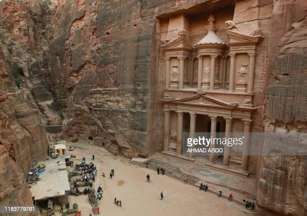 A picture taken on November 21 of the ancient Khaznah monument carved in the rock cliff in the archaeological city of Petra south of the capital...