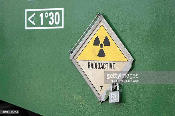 A picture taken on November 22 2011 shows a radioactivity warning symbol on a CASTOR container carrying highly radioactive nuclear waste which is...