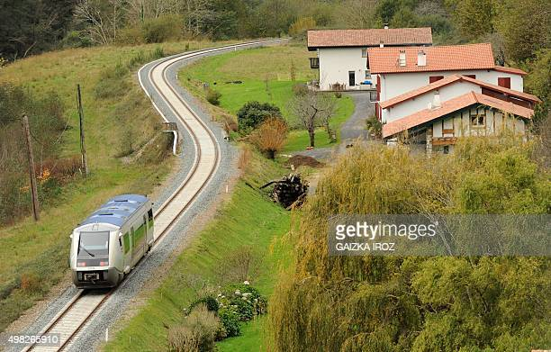A picture taken on November 22 2015 shows a TER Aquitaine regional train in Itxassou on the line between Bayonne and SaintJeanPiedDePort southwestern...