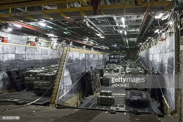 A picture taken on November 22 2016 shows armoured vehicles and trucks aboard the HMS Bulwark naval vessel as it docks at the port in the Israeli...