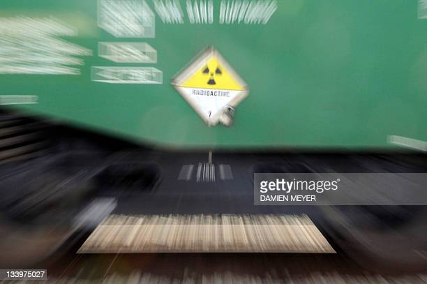 A picture taken on November 23 2011 shows a radioactive warning sign on a train carrying German nuclear waste treated in France as it set off on its...