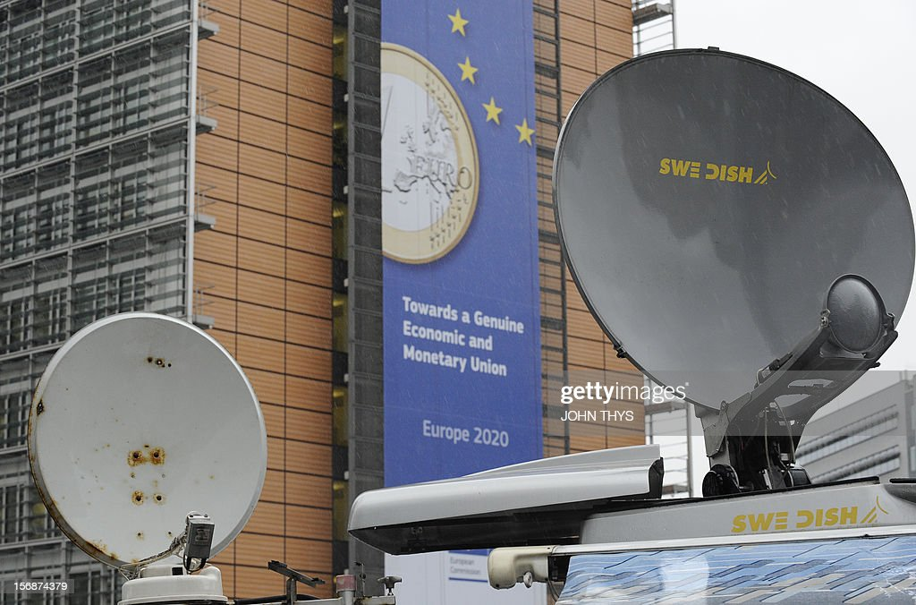 A picture taken on November 23, 2012 in Brussels, shows satellite antennas on broadcast trucks parked near the EU Headquarters, during a two-day European Union leaders summit called to agree a hotl...